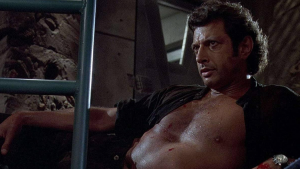 Photo of Jeff Goldblum from Jurassic Park lounging with his shirt open